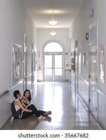 Girls sitting in  school Hallway