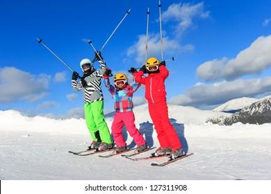 Girls with ski on the mountain