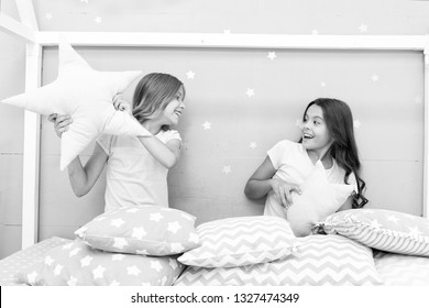 Girls sleepover party ideas. Soulmates girls having fun sleepover party. Girls happy best friends in pajamas with pillows sleepover party. Pillow fight pajama party. Sleepover time for pillow fight.