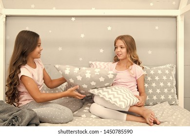Girls sleepover party ideas. Soulmates girls having fun sleepover party. Girls happy friends with cute pillows. Pillow fight pajama party. Sleepover time for pillow fight. Doing whatever they want.