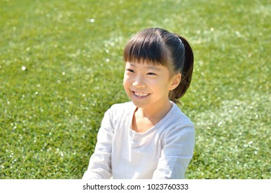 Girl's smiling in the grassland