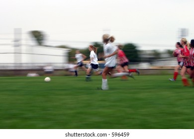 Girls soccer game with a long shutter to show motion of the game.