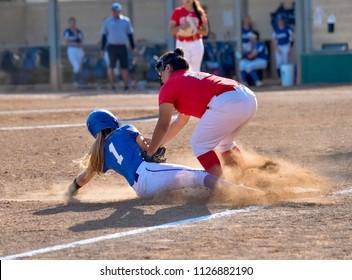 Girl's Softball Player Sliding Into Base