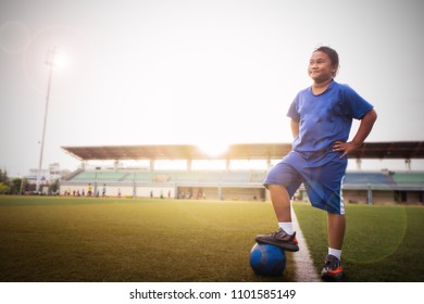 girl's standing on football and looking for a dreams for victory