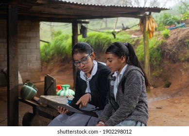 Girls students doing their homework with a digital tablet at home.