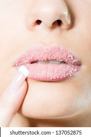 Girl's sweet sugary lips with finger