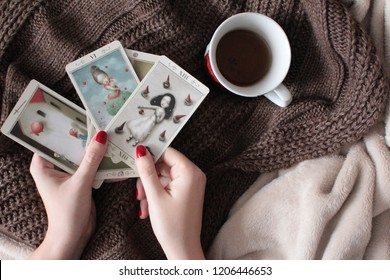 Girls with tarot cards and cup of tea