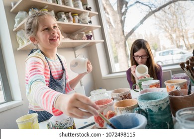 Girls and their hobby pottery painting