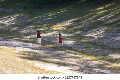 Girls trip into the snow grassland with magic light at the sunrise
