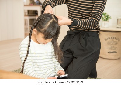 Girls tying their hair