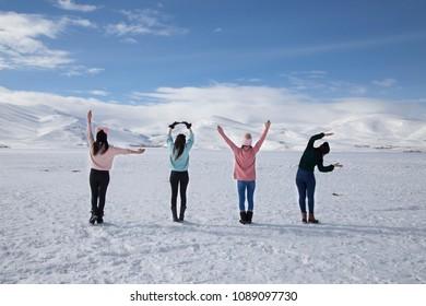"Girls typing ""love"" by using their body on the frozen Cildir Lake (Cildir Golu), Ardahan nearby Kars in Turkey"