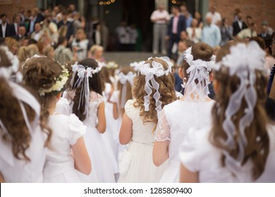 The girls are waiting for the first holy communion.