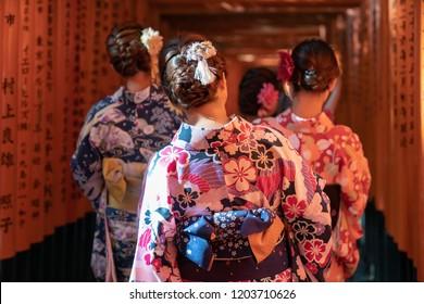 Girls walkin Fushimi Inari Shrine on Geisha attire