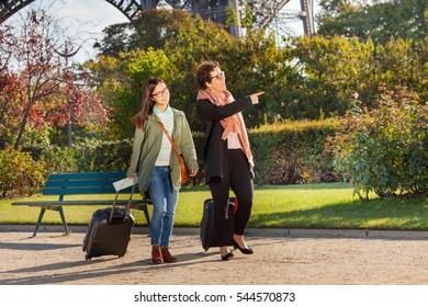 Girls walking along Paris and searching right way