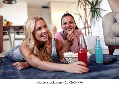 Girls watching movie at home. Concept of leisure time and enjoying together.