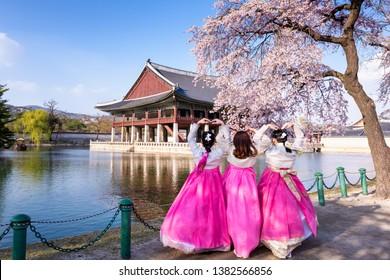 Girls wearing Korean traditional dress Hanbok in Gyeongbokgung palace in spring.