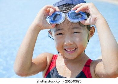 Girls wearing a swimsuit with a goggle