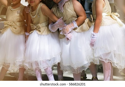 Girls wearing white and gold fairy costume background