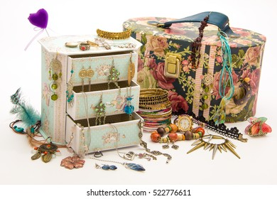 Girl's and wife's jewelry box with drawers - feminine necklace, earrings, bendants, bracelets, rings, kitsch, watch - isolated on white
