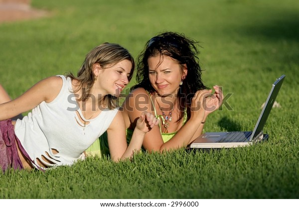Girls working outdoor on laptop