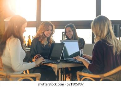 Girls working at their laptops