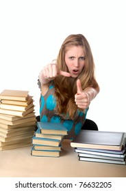 The girl-teenager against books shows a thumb