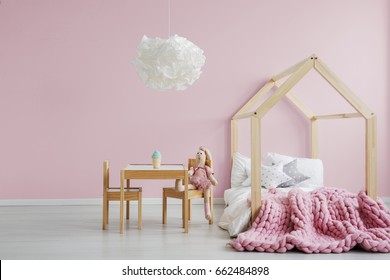 Girly scandi room with wooden house bed