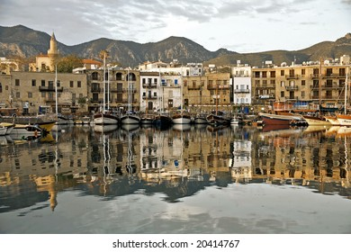 Girne harbour with boats and houses and reflections Marina of Kyrenia in Northern Cyprus