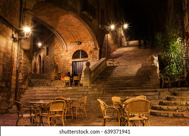Girona city by night, Pujada de Sant Domenec stairs and Arch of the Agullana Palace, Catalonia, Spain