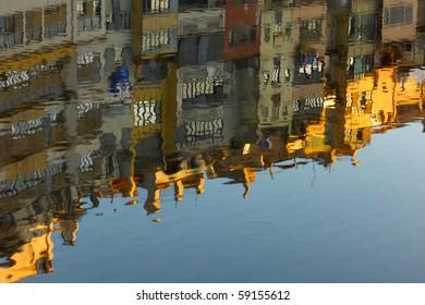Girona reflected in the onya river