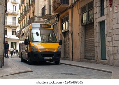 Girona, Spain - 13 May, 2011:  Irisbus minibus based on IVECO Daily chassis driving on the street.