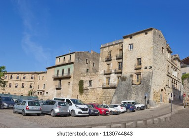 GIRONA, SPAIN - APRIL 20, 2018: Street with ancient buildings in old quarter of the city