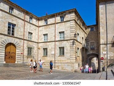 Girona, Spain - April 20, 2018: Cathedral Square with medieval building and sightseeing people