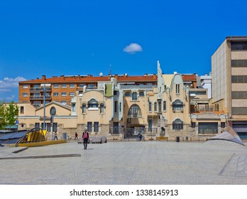 Girona, Spain - April 20, 2018: Cityscape with Art Nouveau building and few people on the street Carrer de Santa Eugènia