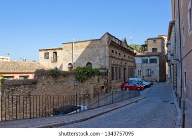 Girona, Spain - April 20, 2018: Narrow street with historical building in old quarter of the city