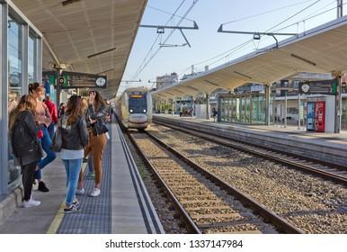 Girona, Spain - April 21, 2018: People on the platform of Girona railway station