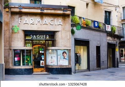 Girona, Spain - January 23, 2019: Pharmacy in Old Town, Girona, Catalyna, Spain