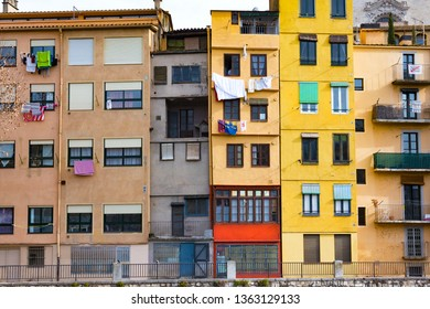 Girona, Spain - January 23, 2019: Colorful houses of Girona in center of city en embankment of Onyar River