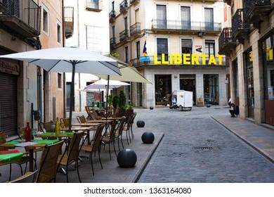 Girona, Spain - January 23, 2019: Narrow street in old town and word Libertad. Girona, Catalonia, Spain
