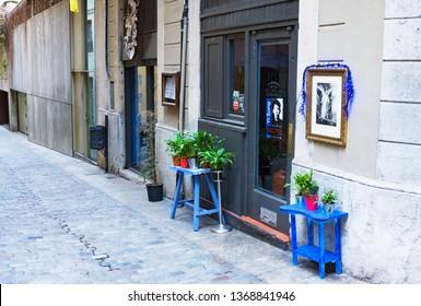 Girona, Spain - January 23, 2019: Narrow street in old town. Girona, Catalonia, Spain