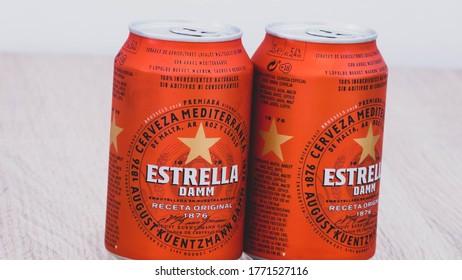 Girona, Spain - July 07, 2020: Closeup of two Estrella Damm beer cans. Estrella Damm - Pilsner beer brewed in Barcelona, Catalonia, Spain.