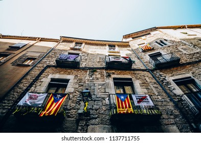 Girona, Spain - July 10, 2018: Catalonia Independence Flags on balconies. The Catalan independence movement is a political movement historically derived from Catalan nationalism
