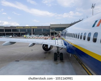 Girona, Spain - July 24 2017: Girona - Costa Brava Barcelona airport. Passengers boarding a Ryanair Boeing 737-800 aircraft on tarmac of GRO airport in the north-east of Catalonia.