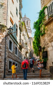 Girona, Spain - July 9, 2018: Old street of Girona Town with tourists on their way to Cathedral of Saint Mary, Catalonia, Spain
