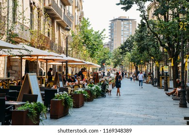 Girona, Spain - July 9, 2018: Rambla de la Libertal is the main street that passes through central girona in Catalonia. The street is lined with cafes and restaurants and a major tourist attraction