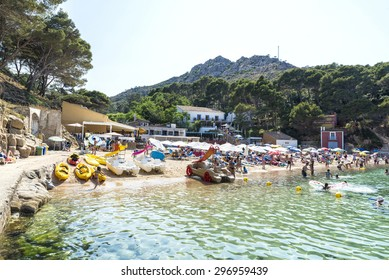 Girona, Spain - June 30, 2015: Aiguablava beach with sunbathers of all ages in Costa Brava, Catalonia, Spain
