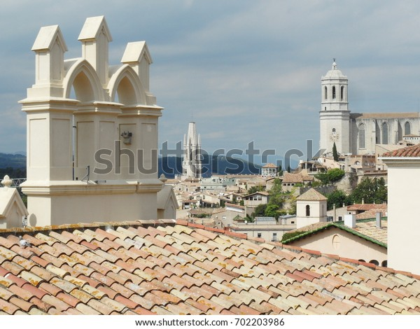 GIRONA, SPAIN - SEPTEMBER 12, 2013:View of the old city from the fortress wall.  In the background the Cathedral on the right, the Church of Sant Feliu to the left.