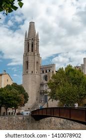 Girona, Spain - September 24 2018: The Collegiate Church of Sant Felix, as seen from the river Onyar, Girona, Spain. Pujada de Sant Feliu.