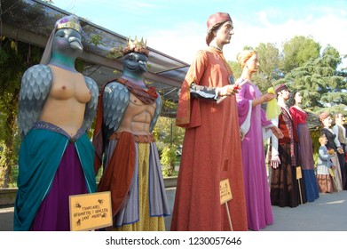 Girona,Catalonia/Spain- November 4 2018: Parade of Giants through Girona city. Photo taken at Migdia Park. Giants, kings and queens stood waiting for the parade. Catalan traditions.