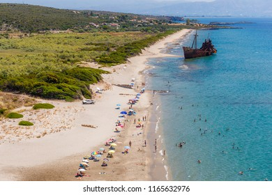 GITHIO, LAKONIA - JULY 2017: The famous Shipwreck of Dimitrios in dusk near Gytheio in Lakonia, Greece. Dimitrios is famous due to its picturesque location on an easily accessible sandy beach near Gyt